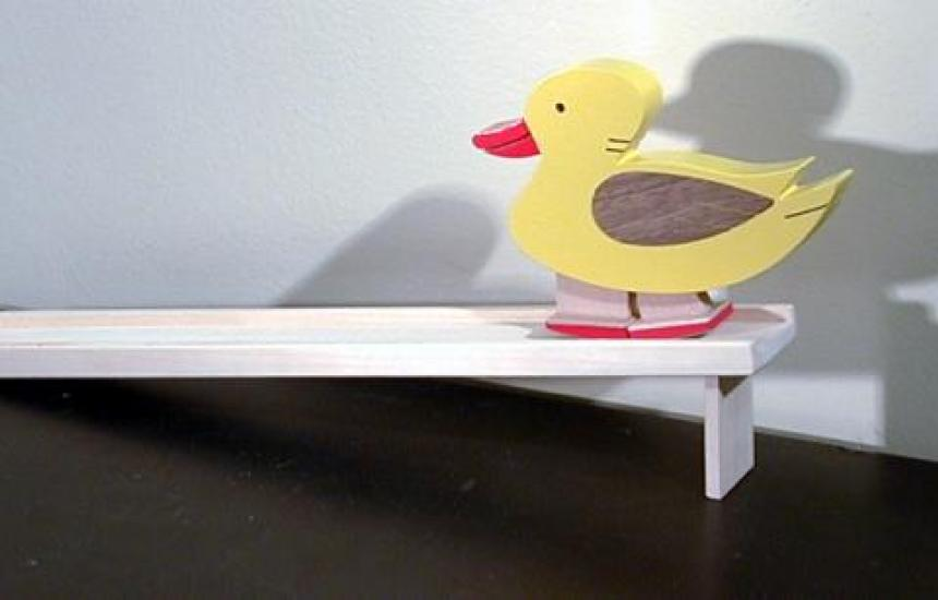 Tap the ducks tail and it waddles down the incline.