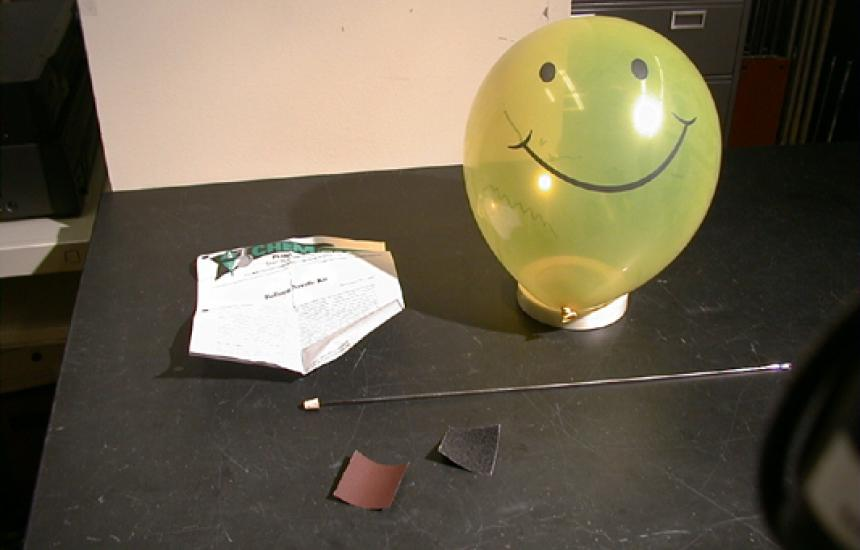 Equipment needed is a balloon, needle, sandpaper and oil.