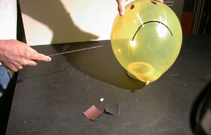 Find the spot where the rubber is thickest. Fill the balloon full then let about