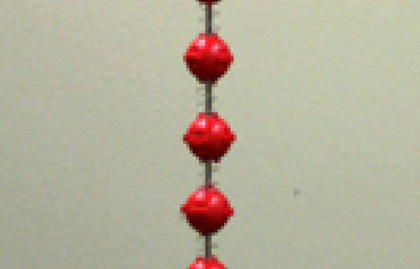 Ball alternating with springs are compressed more at the bottom. This shows how