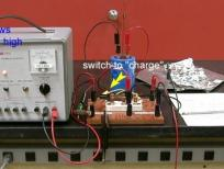 When charging the voltage should be less than 150 V and the current will start a