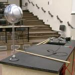 The metal sphere is at the edge of the table so that the VDG can be rolled up to